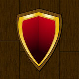 Shield on wooden plaque Stock Images