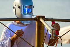 Shielded metal arc welding. Industrial background: shielded metal arc welding Royalty Free Stock Photography