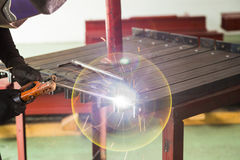 Shielded metal arc welding. SMAW also known as manual metal arc welding MMA or MMAW or flux shielded arc welding, with lens flare causes by arcing light Stock Photos