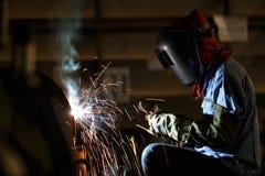 Shielded metal arc welding. Welder fabrication steel structure with shielded metal arc welding Stock Photo