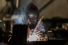 Shielded metal arc welding. Welder fabrication steel structure with shielded metal arc welding Stock Photography