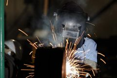 Shielded metal arc welding. Welder fabrication steel structure with shielded metal arc welding Stock Images