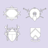 Shields 1. Four line-art generic heraldry crests Stock Image