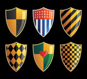 Shields. Various shields set on black background Royalty Free Stock Images