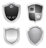 Shields. Metal shield design isolated on white Royalty Free Stock Photography