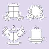 Shields 2. Four line-art generic heraldry crests Stock Photo