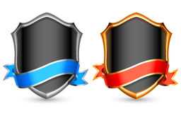 Shields. Silver and golden shields with color ribbons Stock Photos