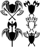 Shields and axes. Detailed design elements - black and white vector emblems collection Stock Photography