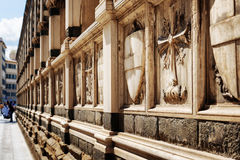 Shields and crosses on sepulchral niches in Santa Maria Novella Stock Photo