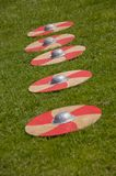 Shields on the grass. A row of shields on the grass royalty free stock photos