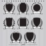 Shields, laurel wreaths and ribbons. Insignia designs set vector shields, laurel wreaths and ribbons Stock Image