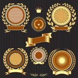 Shields, laurel wreaths and ribbons. Insignia designs set vector shields, laurel wreaths and ribbons Royalty Free Stock Photos