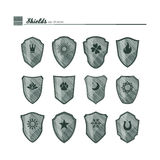 Shields with neutral symbols. Stock Images