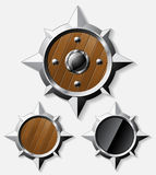 Shields from steel and wood  on grey Royalty Free Stock Photography