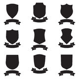 Shields and stylish ribbon set. Different black shield shapes collection. Heraldic royal design. Royalty Free Stock Image
