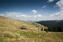 Shieling on a subalpine meadow on a slope of a mountain in the Carpathian mountains Stock Image