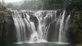 Shifen waterfall scenery. Shifen Waterfall is a scenic waterfall located in Pingxi District, New Taipei City, Taiwan, on the upper reaches of the Keelung River stock video footage