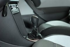 Shift knob. Detail of the interior of the car with the gear shifter stock image
