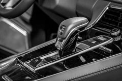 The shift knob of the full-size luxury car Porsche Panamera Turbo, 2016. Royalty Free Stock Images