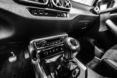 The shift knob of mid-size luxury pickup truck Mercedes-Benz X-Class X220d 4Matic. BERLIN - DECEMBER 21, 2017: Showroom. The shift knob of mid-size luxury stock photos