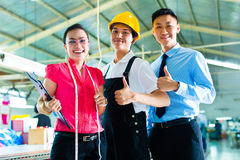 Worker, manager and designer in Chinese factory Royalty Free Stock Photography