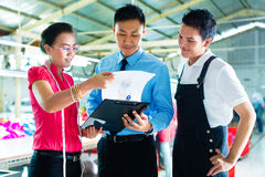Worker, manager and designer in garment factory Royalty Free Stock Photography