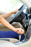 Shifting car gear stick Stock Images