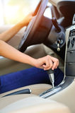 Shifting car gear stick. Woman driving a car and shifting the gear stick Stock Photography