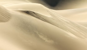 Shifting sand dune contrasts. Desert or beach sand textured background. Royalty Free Stock Images