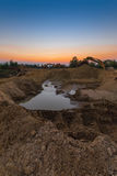 Shifting sands, sunset. Shifting sands, Excavator shifting sand Stock Image