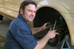 Shifty Mechanic. A shifty looking, dishonest mechanic taking advantage of you Royalty Free Stock Photos