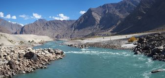 Shigar river with rock mountain and blue sky in background royalty free stock photography
