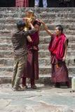 Tibetan Buddhist monks prepare butter tea in courtyard of Tashilhunpo Monastery . Shigatse , Tibet stock photos