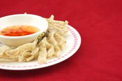 Shiitake mushroom snack in plate. With chilli sauce placed on a red background Royalty Free Stock Images