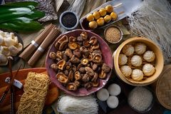 Shiitake rice dumplings steamed pork buns noodles. Asian cuisine food mix Royalty Free Stock Images