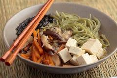 Shiitake, soba, and tofu soup Royalty Free Stock Photo
