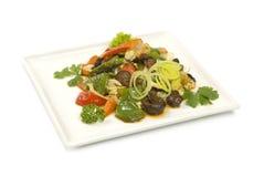 Shiitakechampinjoner som bräseras med grönsaker Arkivbild