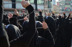 Shiite Muslim women hold up their chained hands. Royalty Free Stock Photo