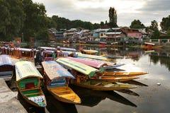 Shikara boats on Dal Lake with houseboats in Srinagar Royalty Free Stock Photos