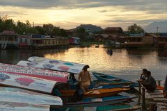 Shikara boats on Dal Lake with houseboats in Srinagar Royalty Free Stock Images