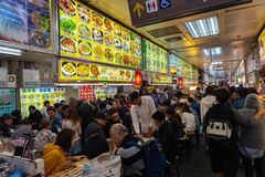 Shilin Night Market food court. A popular and famous destination, endless food stalls, crowds. Largest night market in Taiwan. People get eat, drink and stock image