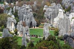 Shilin stone forest, world-famous natural karst area, China. Tourists in Shilin stone forest, world-famous natural area of limestone formations and UNESCO World stock photos