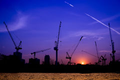 Shillouette contruction and cranes beside the Rive Royalty Free Stock Photo