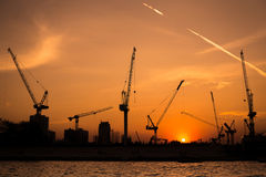 Shillouette contruction and cranes beside the Rive Stock Photo