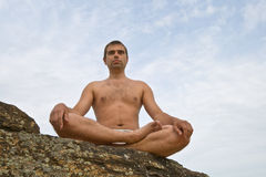 Shilouette of man meditating on the mountain Royalty Free Stock Images