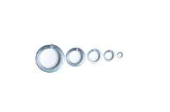 Shim, spring washer, Grover washer, detail. Screw, detail of bolting, obstacle unwinding Royalty Free Stock Photos