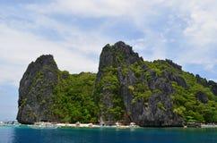 Shimizu Island, El Nido. The sharp rocks and surrounding vibrant water of Shimizu Island, El Nido, Philippines royalty free stock images