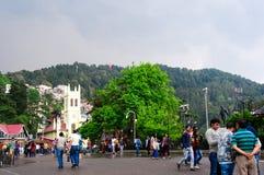 People roaming around on the ridge in Shimla. Shimla, India - 27th Apr 2018: People roaming around on the ridge in shimla with the christ church in the Royalty Free Stock Image