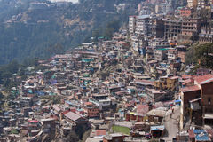 Shimla Townscape. Housing on a densely populated  hillside in Northern India. Shimla, in the foothills of the Himalayas, was the summer headquarters of the Royalty Free Stock Photos