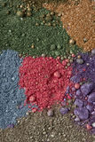 Shimmer eyeshadow. Eyeshadow shimer crumbly pigment dust royalty free stock photos